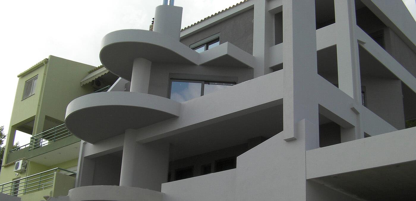 κτίριο που εφαρμόστηκαν μόνωσης ταράτσας και εξωτερική θερμομόνωση