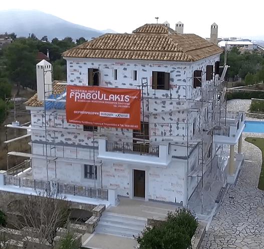 κτίριο μετα την εφαρμογή συστήματος θερμοπρόσοψης