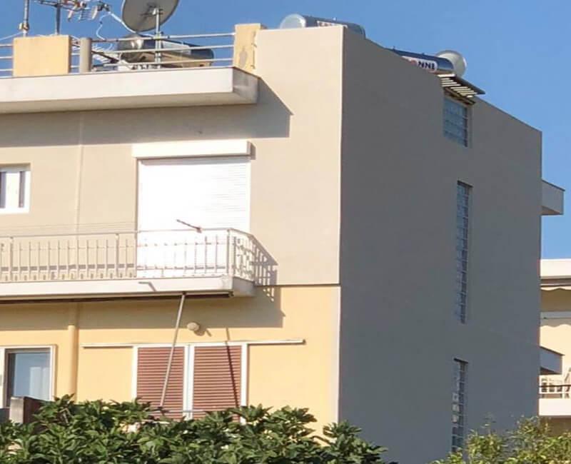 κατοικία στο Πόρτο Ράφτι που έχει γίνει εφαρμογή εξωτερικής θερμομόνωσης